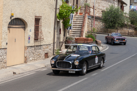 classic car Ferrari 212 Inter Coupé Pinin Farina (1953) travels in village of Tuscany during the historical race Mille Miglia, in Colle di Val dElsa, Siena, Italy - May 17, 2014