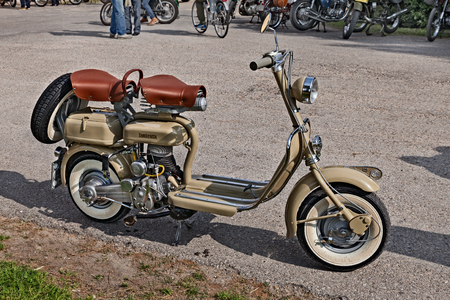 vintage Italian scooter of the fifties Lambretta 125 in classic cars and motorcycle rally - 15th auto moto raduno - in Piangipane, RA, Italy - April 25, 2015