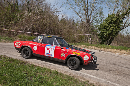 vintage racing car Fiat 124 Abarth running in 12th Rally della Romagna. Cesena, Italy - April 8, 2018