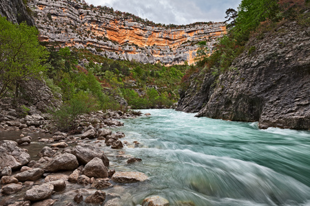 Verdon Gorge, Provence, France: hiking in the canyon on the nature park with the creek and the rapids where the water flowing fast Stock Photo