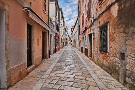 Porec, Istria, Croatia: picturesque old alley with ancient houses in the medieval town