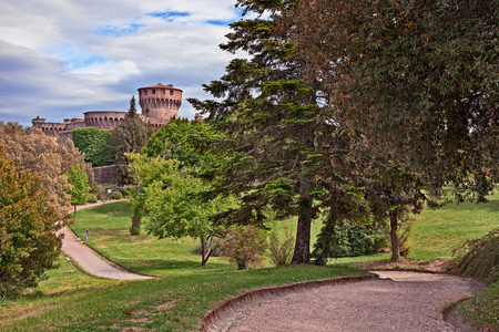 Volterra, Pisa, Tuscany, Italy: landscape of the park with pathway and the medieval castle Editorial