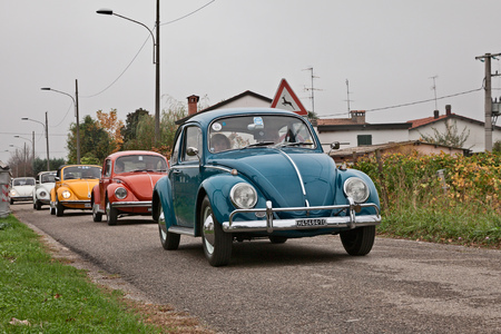 line of vintage Volkswagen Type 1 Beetle of the sixties-seventies travels during the classic car rally Battesimo dell'aria, on november 4, 2018 in Lugo, RA, Italy