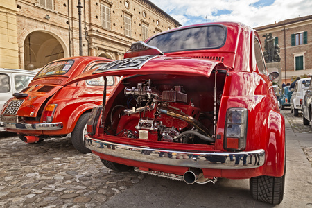 Vintage Italian car Fiat 500 with tuning chromed engine Abarth 595 in 24th Meeting auto vintage in November 11, 2018 in Bagnacavallo, RA, Italy