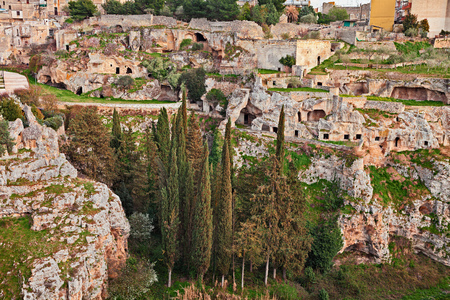 Gravina in Puglia, Bari, Italy: landscape of the old town with the ancient cave houses in the ravine wall