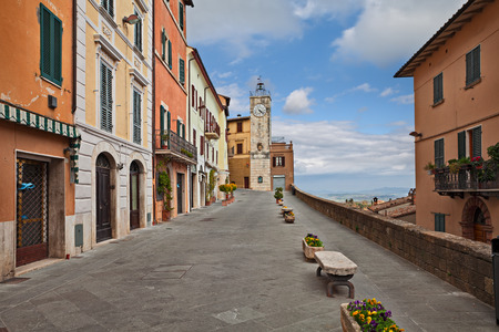 Chianciano Terme, Siena, Tuscany, Italy: panoramic street in the old town with ancient buildings, the clock tower and flower pots