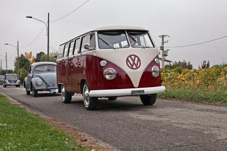 Vintage van Volkswagen Transporter Type 2 T1 Split travels during the classic car rally Battesimo dellaria, on november 4, 2018 in Lugo, RA, Italy