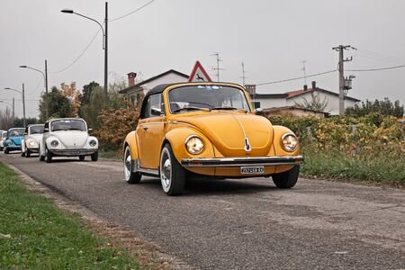 Vintage German car Volkswagen Type 1 (Beetle) Cabriolet traveling during the classic car rally Battesimo dellaria, on november 4, 2018 in Lugo, RA, Italy