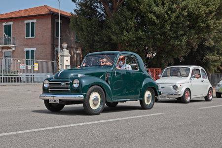 Vintage Fiat 500 C Topolino Trasformabile (ca. 1950) in classic car rally 33st Raduno moto e auto depoca in Bagnara di Romagna, RA, Italy - July 29, 2018