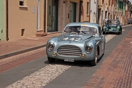 Vintage sportscar Cisitalia 202 SC Berlinetta Pininfarina (1948) in classic car race Mille Miglia, the italian historical race (1927-1957) in Gatteo, FC, Italy - May 19, 2017 Редакционное