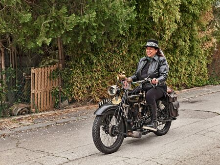 Biker woman riding vintage AJS G2 800 cc V-twin engine (1926) in classic motorcycle rally Circuito di San Pietro in Trento on April 15, 2018 in Ravenna, Italy Editorial