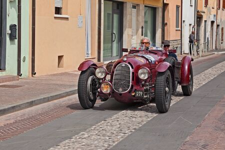 Vintage racing car Alfa Romeo 8C 2900 A Botticella (1936), that ran managed by Scuderia Ferrari, in historical classic race Mille Miglia, on May 19, 2017 in Gatteo, FC, Italy Редакционное