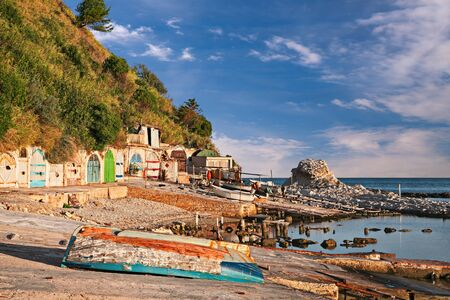 Ancona, Marche, Italy: the metropolitan beach of Passetto with the colored doors of the caves carved into the rock to shelter the fishing boats