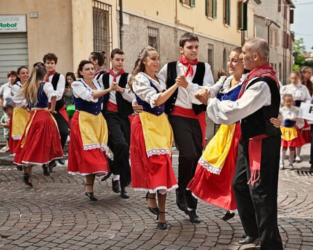 folk ensemble Gruppo Folkloristico Canterini Romagnoli performs traditional Romagna dance in the town street during the International Folklore Festival, on August 2, 2015 in Russi, Ravenna, Italy Redakční