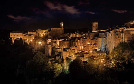 Sorano, Grosseto, Tuscany, Italy: night landscape of the picturesque medieval hill town Stock Photo