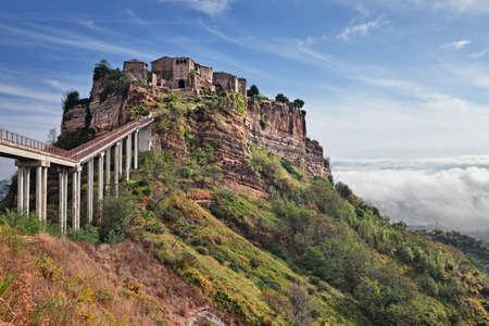 Civita di Bagnoregio, Viterbo, Lazio, Italy: landscape at sunrise of the ancient village founded in Etruscan time on the steep tuff hill