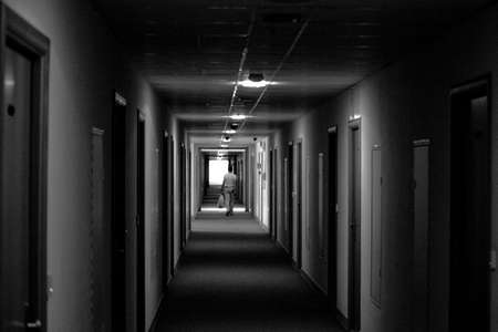 interested: the darkness of the hallway and the man to do His interested me Stock Photo