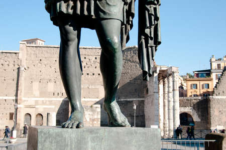 incorporates: Photos which incorporates a Roman statue in the background to and the holes are visible Roman forums Stock Photo