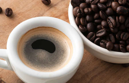 repose: Cup of coffee with beans Stock Photo
