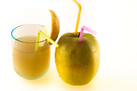 Apple juice with glass and straw