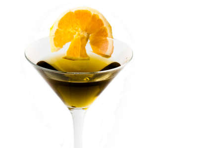 bellini: glass of alcoholic drink cocktail with orange slices and cubes on white background Stock Photo