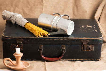 old items: an old cardboard suitcase with vintage items Stock Photo