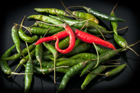 wor: green chili peppers and red Stock Photo