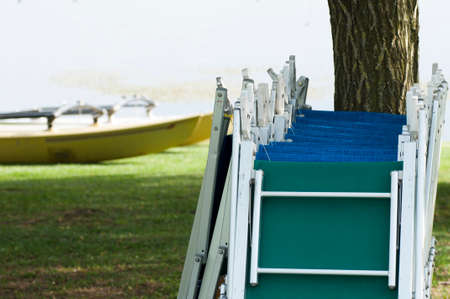 sunbeds: empty sunbeds in line at the lake.