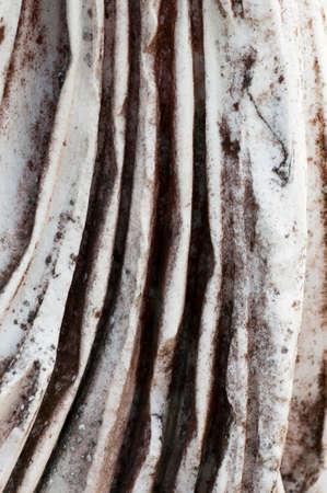 vestal: detail of a drape ancient vestal marble Stock Photo
