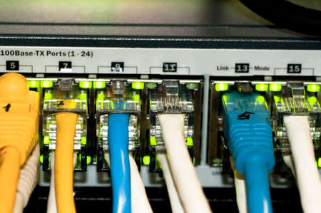 network switch: Ethernet Network Switch with ethernet cables Stock Photo