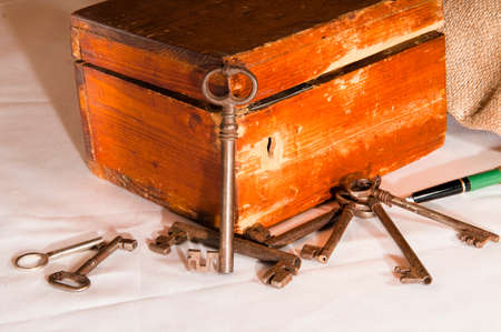 large doors: antique keys next to an old wooden box