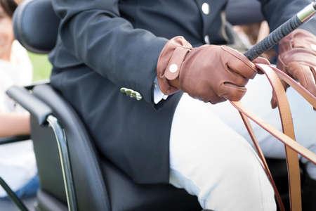 coachman: detail of dress of a coachman