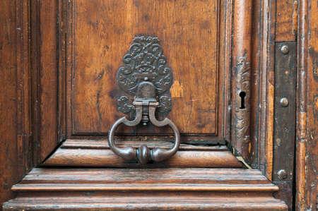 doorknocker: Royal style doorknocker on old wooden door.