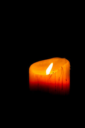 lighted: lighted candle in the dark