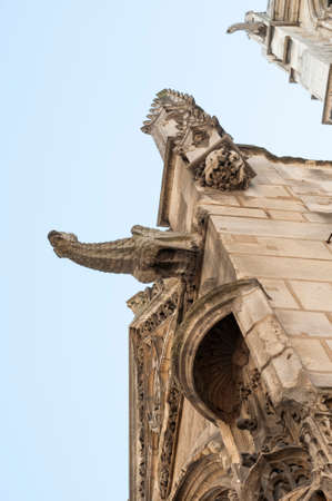 gargoyles: View of a typical French architecture with gargoyles sprouting of a church facade