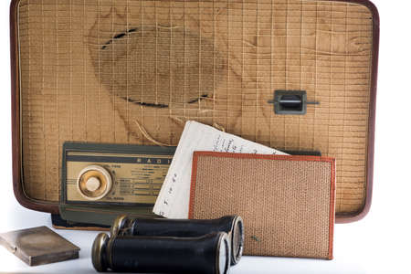 shortwave: some vintage and antique objects including a radio, binoculars and an old letter Stock Photo