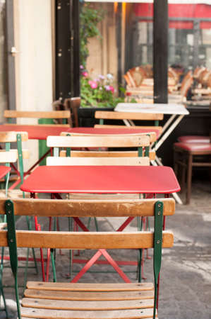 kafe: colored tables and chairs outside a bistro in Paris