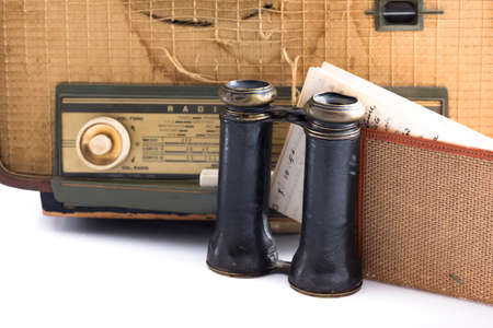 antique binoculars: some vintage and antique objects including a radio, binoculars and an old letter Stock Photo
