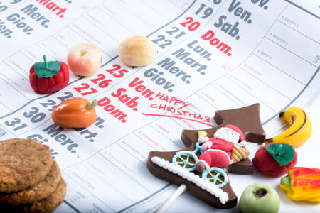 marked boxes: calendar with Christmas day marked beside decorations and sweets