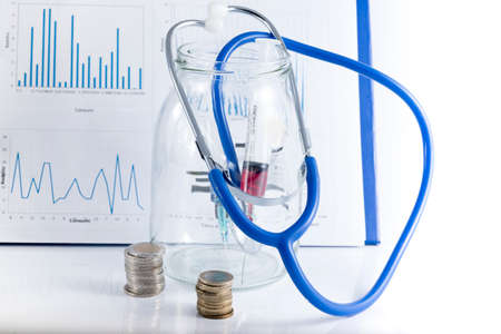 health reform: conceptual image with medicine and money. Stock Photo
