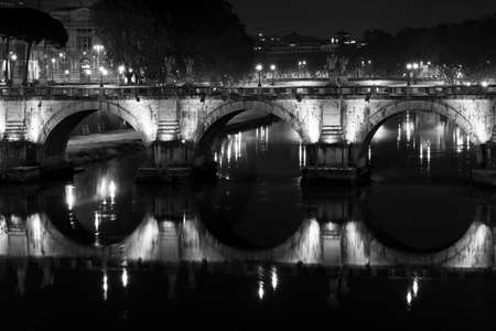 vittorio: image of bridge Vittorio Emanuele reflection on the river Tiber.