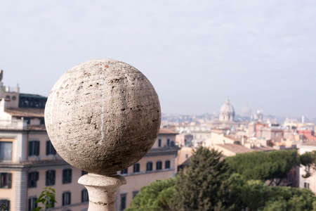 emporium: close-up of a ball of travertine marble with the background the view of Rome Stock Photo