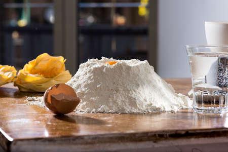 fettuccine: fresh homemade fettuccine on the kitchen table. Italian