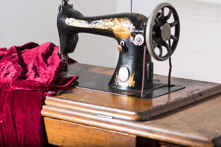 tailoring: antique sewing machine in a study tailoring.