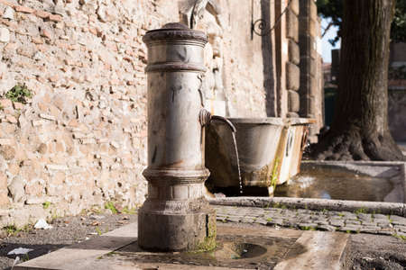 throughout: typical Roman fountain deployed throughout the territory of Rome Stock Photo