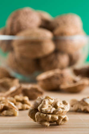 represent: pile of walnuts in the foreground represent a healthy diet Stock Photo