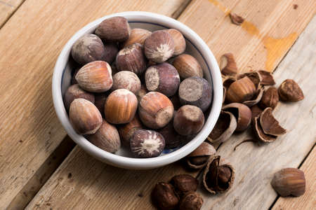cobnut: Close-up of hazelnuts on wooden table.