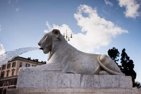 beautiful fountain shaped like a lion in Piazza del Popolo.