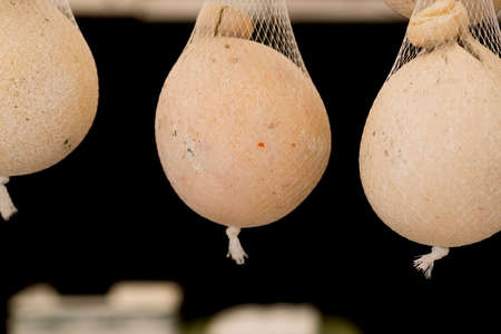 caciocavallo: caciocavallo cheese hanging with string for sale at the market