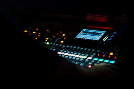 music background: Audio mixer mixing board fader and knobs, Music mixing console